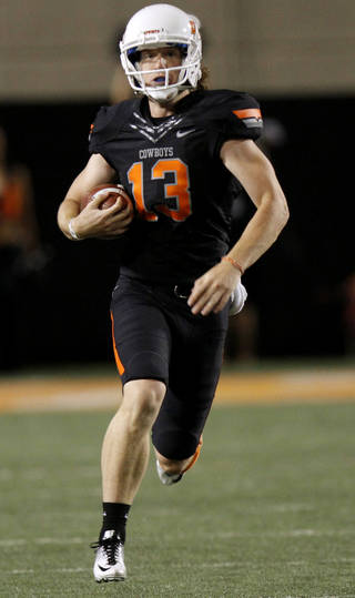Oklahoma State's Quinn Sharp runs the ball on a fake punt during the Cowboys 37-14 win over Arizona on Thursday in Stillwater. PHOTO BY BRYAN TERRY, The Oklahoman