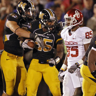 Missouri's Zaviar Gooden celebrate an interception in front of Oklahoma's Ryan Broyles (85) during the second half of the college football game between the University of Oklahoma Sooners (OU) and the University of Missouri Tigers (MU) on Saturday, Oct. 23, 2010, in Columbia, Mo. Oklahoma lost the game 36-27. Photo by Chris Landsberger, The Oklahoman