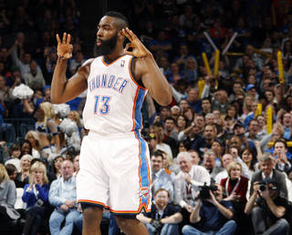 Oklahoma City's James Harden (13) reacts after hitting a three-point shot in the first half during the NBA basketball game between the Detroit Pistons and Oklahoma City Thunder at the Chesapeake Energy Arena in Oklahoma City, Monday, Jan. 23, 2012. Photo by Nate Billings, The Oklahoman