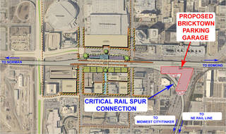 This master plan, assembled by Jacobs Associates as part of studies for an intermodal hub at Santa Fe depot, shows how a potential garage to be built on surface lots north of Main Street (center right of the map) might interfere with future rail connections (markings made by rail advocate Marion Hutchison). Provided