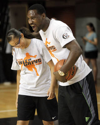 "FORMER OKLAHOMA STATE UNIVERSITY / OSU / COLLEGE BASKETBALL PLAYER / NBA BASKETBALL PLAYER / CHILD / CHILDREN / KIDS: Former Oklahoma State basketball player and current Memphis Grizzlies player Tony Allen embraces Lizbeth Galvan, 14 of Oklahoma City, after she got a ball by him to make a layup at his ""Grit and Grind"" basketball camp at Gallagher-Iba Arena on July 31, 2013. Photo by KT KING, The Oklahoman"