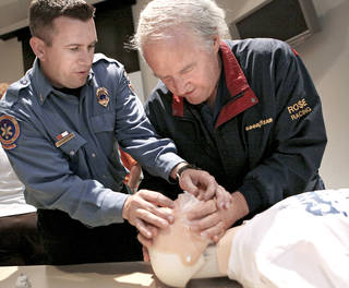 Right: Lt. Chad Weaver, left, helps Larry Rose, of Edmond, during a CPR class at the Edmond Fire Department during this year's Citizen Fire Academy. PHOTO BY JOHN CLANTON, OKLAHOMAN ARCHIVE