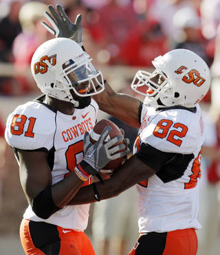 OSU's Justin Blackmon (81) and Isaiah Anderson (82) celebrate after a touchdown catch by Blackmon in the third quarter during the college football game between the Oklahoma State University Cowboys and Texas Tech University Red Raiders at Jones AT&T Stadium in Lubbock, Texas, Saturday, October 16, 2010. OSU won, 34-17. Photo by Nate Billings, The Oklahoman