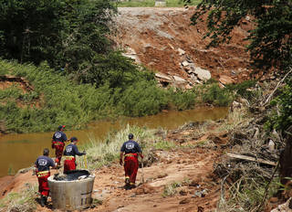 Oklahoma City firefighters search for drowning victims Monday, June 3, 2013, along a creek north of NE 63, east of Bryant. Photo by Jim Beckel, The Oklahoman Jim Beckel - THE OKLAHOMAN