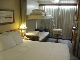 The staterooms in Disney Magic are cleverly designed and comfortable. The top bunk in the bakcground stows away in the ceiling and the bed below converts into a couch. DON MECOY - THE OKLAHOMAN