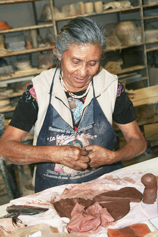 Guillermina Aguilar workis with clay to make folk art chicken vases. PHOTO BY STEVE MAUPIN, FOR THE OKLAHOMAN Copyright Steven N. Maupin