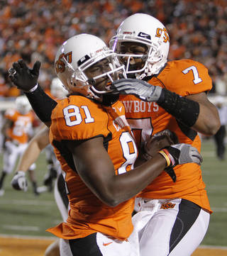Oklahoma State's Justin Blackmon (81) and Michael Harrison (7) celebrate Blackmon's touchdown during the Bedlam college football game between the University of Oklahoma Sooners (OU) and the Oklahoma State University Cowboys (OSU) at Boone Pickens Stadium in Stillwater, Okla., Saturday, Nov. 27, 2010. Photo by Chris Landsberger, The Oklahoman