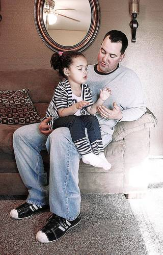 Dusten Brown relaxes with his daughter Veronica Capobianco, 3. Tulsa World photo