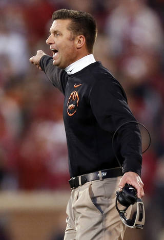 OSU head coach Mike Gundy yells at an official during the Bedlam college football game between the University of Oklahoma Sooners (OU) and the Oklahoma State University Cowboys (OSU) at Gaylord Family-Oklahoma Memorial Stadium in Norman, Okla., Saturday, Nov. 24, 2012. OU won, 51-48 in overtime. Photo by Nate Billings , The Oklahoman