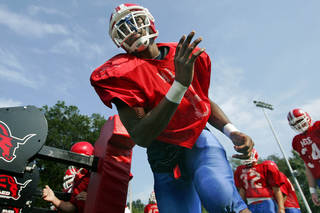 Justin McCay, a senior high school football player at Bishop Miege, is the No. 1 recruit in the Kansas City area, according to Rivals.com. He was essentially raised by one parent and is looking at his senior year as his introduction to manhood. With a lot on his plate already, he is taking his football skills to the University of Oklahoma (OU). McCay runs through drills on Wednesday, September 02, 2009. CHRIS OBERHOLTZ/The Kansas City Star ORG XMIT: CH1BCAPE ORG XMIT: LJ1DPV8F