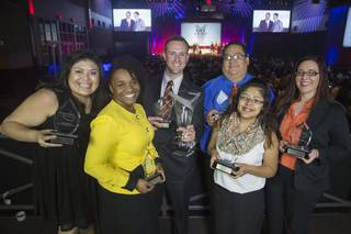 Members of the Donald W. Reynolds Governor's Cup team smile with their first-place trophies. From left are Mayra Tello, Jennifer Bradley, Shane Barlow, Mario Young, Amanda Sandoval and team adviser Amber Hefner. Photo provided