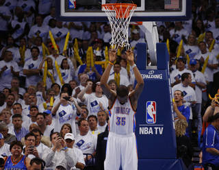 Oklahoma City's Kevin Durant (35) hangs on the net during a timeout in Game 5 in the second round of the NBA playoffs between the Oklahoma City Thunder and the Memphis Grizzlies at Chesapeake Energy Arena in Oklahoma City, Wednesday, May 15, 2013. Memphis won 88-84. Photo by Bryan Terry, The Oklahoman