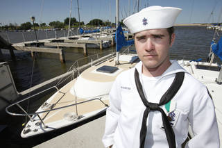 Matt Lebo, 21, of Mustang, who earned his Quartermaster Award in the Sea Scouts, is on the dock at Lake Hefner.