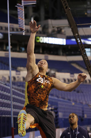 Oklahoma offensive lineman Lane Johnson goes through a drill during the NFL football scouting combine in Indianapolis Saturday, Feb. 23, 2013. (AP Photo/Dave Martin) ORG XMIT: INDM103