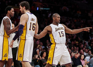Los Angeles Lakers forward Metta World Peace points in celebration after scoring during the second half of an NBA basketball game, Sunday, April 15, 2012, in Los Angeles. The Lakers won, 112-108, in overtime. (AP Photo/Bret Hartman) ORG XMIT: CABH112
