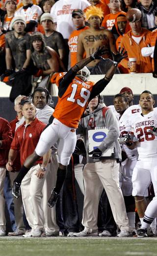 Oklahoma State's Brodrick Brown (19) tips a Oklahoma's Landry Jones (12) pass in bounds during the Bedlam college football game between the University of Oklahoma Sooners (OU) and the Oklahoma State University Cowboys (OSU) at Boone Pickens Stadium in Stillwater, Okla., Saturday, Nov. 27, 2010. Photo by Sarah Phipps, The Oklahoman