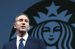 FILE - In this March 20, 2013 file photo, Starbucks CEO Howard Schultz speaks at the company's annual shareholders meeting, in Seattle, Wash. From Wednesday, Oct. 9, 2013, to Friday, Oct. 11, 2013, the coffee chain is offering a free tall brewed coffee to any customer in the U.S. who buys another person a beverage at Starbucks. The offer is a way to help fellow citizens ¬¨a¨support and connect with one another, even as we wait for our elected officials to do the same for our country,¬¨aÆ Schultz said in a memo to staff on Tuesday. (AP Photo/Ted S. Warren, File) ORG XMIT: NY208