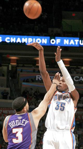Kevin Durant, right, and the Thunder starters should play tonight to build momentum for the postseason. PHOTO BY SARAH PHIPPS, THE OKLAHOMAN