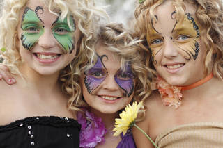 Sisters from left, Emily Blackburn, 10, Anna Blackburn, 9, and Raven Buchanan, 10, show off their face paint during the Fairy Ball in the Paseo Saturday, September 24, 2011. Photo by Doug Hoke, The Oklahoman. ORG XMIT: KOD Doug Hoke - THE OKLAHOMAN