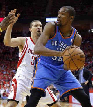 Oklahoma City's Kevin Durant (35) looks to pass beside Houston's Francisco Garcia (32) during Game 4 in the first round of the NBA playoffs between the Oklahoma City Thunder and the Houston Rockets at the Toyota Center in Houston, Texas,Sunday, April 29, 2013. Photo by Bryan Terry, The Oklahoman