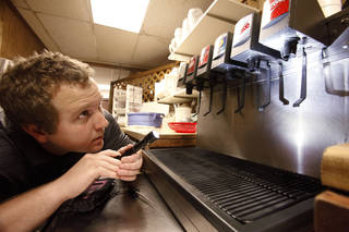 OCCHD health inspector Jacob Custer inspects the soda dispenser in a restaurant in Midwest City, Thursday, July 26, 2012. Photo By David McDaniel/The Oklahoman