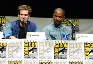 """Andrew Garfield, left, and Jamie Foxx attend the """"The Amazing Spider-Man 2"""" panel on Day 3 of Comic-Con International in San Diego. AP Photo Jordan Strauss - Jordan Strauss/Invision/AP"""