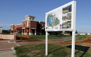 A sign shows what Legacy Park will look like when it is completed in Norman. The park is under construction on 24th Avenue NW, just north of Robinson Street. PHOTO BY STEVE SISNEY, THE OKLAHOMAN STEVE SISNEY