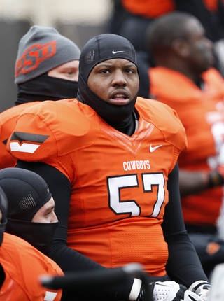Oklahoma State offensive lineman Paul Lewis (57) is pictured during an NCAA college football game between Oklahoma State and Oklahoma in Stillwater, Okla., Saturday, Dec. 7, 2013. (AP Photo/Sue Ogrocki)