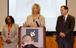 Angela Monson, chairwoman of the Oklahoma City School Board, speaks Thursday during a news conference about the grade scandal at Douglass Mid-High School. Douglass interim Principal Barbara Davis, left, and Oklahoma City Superintendent Karl Springer stand beside her. Photo by Carrie Coppernoll, The Oklahoman