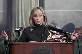 Oklahoma Gov. Mary Fallin speaks to the media during a legislative forum at the Oklahoma State Capitol, Thursday, Feb. 2, 2012 in Oklahoma City. Gov. Mary Fallin says her plan to reduce Oklahoma's income tax will reduce the number of tax brackets from seven to three and will include revenue growth criteria that will trigger future tax cuts. (AP Photo/Alonzo Adams)