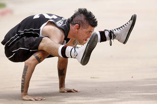 """Right: Al Millar, """"The Human Knot,"""" is the event's official street performer. Photos by Jim Beckel, The Oklahoman"""