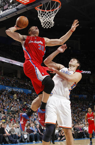 Los Angeles' Blake Griffin (32) goes to the basket beside Oklahoma City's Nenad Krstic (12) during the NBA basketball game between the Oklahoma City Thunder and the Los Angeles Clippers at the Oklahoma CIty Arena, Tuesday, Feb. 22, 2011. Photo by Bryan Terry, The Oklahoman