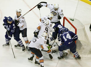 OKC Barons get into a jumble near the Barons' goal as they play the Toronto Marlies during Field Trip Day at the Cox Convention Center in Oklahoma City, OK, Tuesday, Nov. 8, 2011. By Paul Hellstern, The Oklahoman ORG XMIT: KOD
