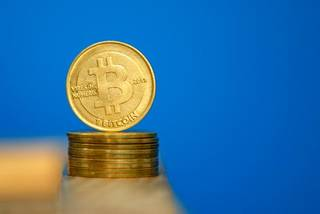 Bitcoin (virtual currency) coins are seen in an illustration picture taken at La Maison du Bitcoin in Paris July 11, 2014. French police dismantled an illegal Bitcoin exchange and seized 388 virtual currency units worth some 200,000 euros ($272,800) in the first such operation in Europe a public prosecutor said on Monday.