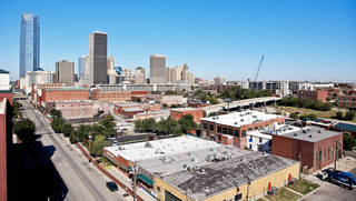 Above: This photo looks northwest from Bricktown toward downtown Oklahoma City, top left, and Deep Deuce, top right. PHOTO BY CHRIS LANDSBERGER, THE OKLAHOMAN ARCHIVE