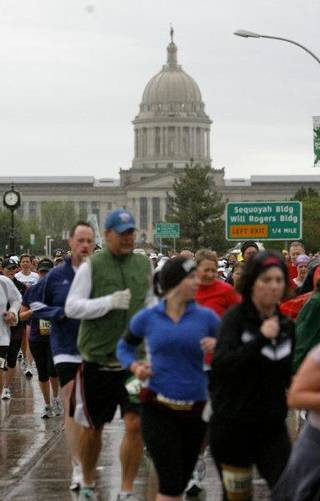 Runners pass the state Capitol during the 11th annual Oklahoma City Memorial Marathon on Sunday. SARAH PHIPPS - THE OKLAHOMAN