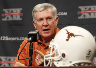 Texas football coach Mack Brown addresses the media during the Big 12 Conference Football Media Days Monday, July 23, 2013 in Dallas. (AP Photo/Tim Sharp) ORG XMIT: TXTS104