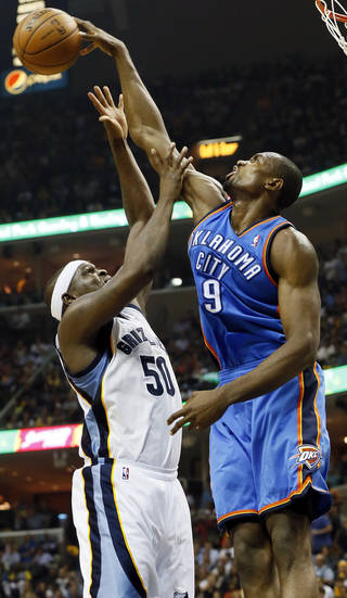 Oklahoma City's Serge Ibaka (9) blocks the shot of Memphis' Zach Randolph (50) during Game 3 in the second round of the NBA basketball playoffs between the Oklahoma City Thunder and Memphis Grizzles at the FedExForum in Memphis, Tenn., Saturday, May 11, 2013. Memphis won, 87-81. Photo by Nate Billings, The Oklahoman