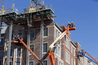 Workers on cranes continue construction of Headington Hall on Feb. 14 in Norman. PHOTO BY STEVE SISNEY, THE OKLAHOMAN