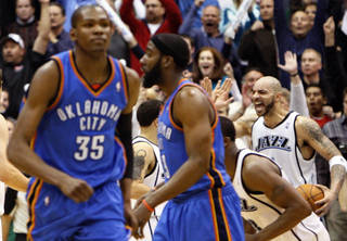 Thunder forward Kevin Durant, left, walks off the court after missing a last second shot in overtime. Utah beat OKC, 140-139. AP PHOTO