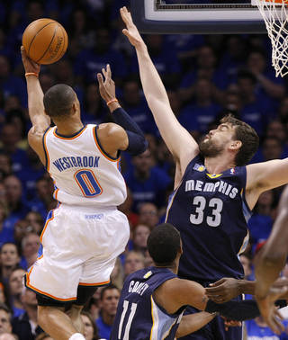 Marc Gasol (33) of Memphis tries to stop Oklahoma City's Russell Westbrook (0) during game two of the Western Conference semifinals between the Memphis Grizzlies and the Oklahoma City Thunder in the NBA basketball playoffs at Oklahoma City Arena in Oklahoma City, Tuesday, May 3, 2011. Photo by Chris Landsberger, The Oklahoman
