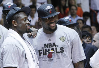 Miami Heat's Dwyane Wade, left, and LeBron James stand together during the trophy presentation following the Heat's 101-88 victory over the Boston Celtics in Game 7 in the NBA basketball Eastern Conference Finals playoff series, Saturday, June 9, 2012, in Miami. (AP Photo/Lynne Sladky) ORG XMIT: AAA153