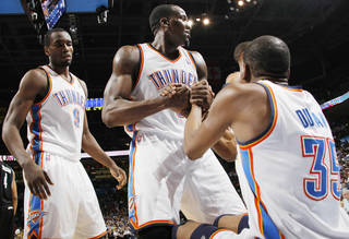 Oklahoma City's Kendrick Perkins (5), middle, helps Kevin Durant (35) get up next to Serge Ibaka (9) during the NBA basketball game between the Minnesota Timberwolves and the Oklahoma City Thunder at the OKC Arena in Oklahoma City, Friday, March 25, 2011. Photo by Nate Billings, The Oklahoman