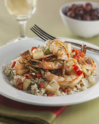 Serve bacon-fat fried shrimp with vegetables over rice at your Super Bowl party. MCT Photo