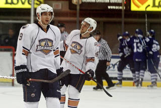 AHL HOCKEY / REACTION: Tyler Pitlick, left, and Antti Tyrvainen of Oklahoma City react after Toronto scored a goal during Game 1 of AHL Western Conference finals between the Oklahoma City Barons and the Toronto Marlies at the Cox Convention Center in Oklahoma City, Thursday, May 17, 2012. Photo by Bryan Terry, The Oklahoman