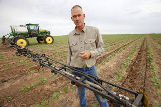 Matt Muller talks Tuesday about the impact of the drought in Oklahoma has had on his farm's crops near Martha . Photos by David McDaniel, The Oklahoman David McDaniel - The Oklahoman