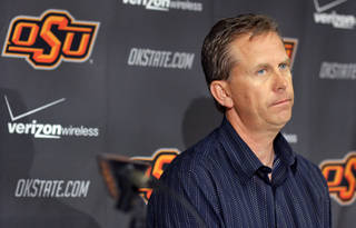 NEW OSU ASSISTANT COLLEGE FOOTBALL COACHES: Oklahoma State University's new offensive coordinator Todd Monken addresses the media during a press conference at Gallagher-Iba Arena on Monday, Feb. 14, 2011, Stillwater, Okla. Photo by Chris Landsberger, The Oklahoman ORG XMIT: KOD