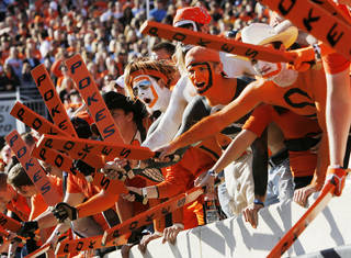OSU fans beat their paddles during a college football game between the Oklahoma State University Cowboys (OSU) and the Baylor University Bears (BU) at Boone Pickens Stadium in Stillwater, Okla., Saturday, Oct. 29, 2011. Photo by Nate Billings, The Oklahoman NATE BILLINGS