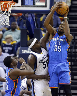 Oklahoma City's Kevin Durant (35) grabs a rebound as Memphis' Zach Randolph (50) defends during Game 6 in the first round of the NBA playoffs between the Oklahoma City Thunder and the Memphis Grizzlies at FedExForum in Memphis, Tenn., Thursday, May 1, 2014. Photo by Bryan Terry, The Oklahoman