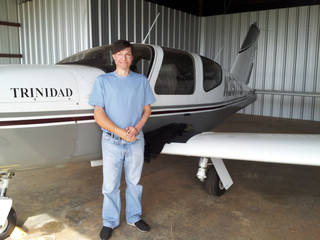 Matt Cole is shown near his plane Trinidad at the Guthrie-Edmond Regional Airport. A 2001 crash altered Cole's career path. He is now a flight instructor at the airport. Photo provided